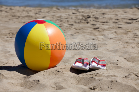 beach ball and flip flops