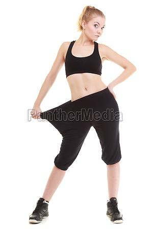 glückliche, frau, zeigt, wie, viel, gewicht, sie - 10609571