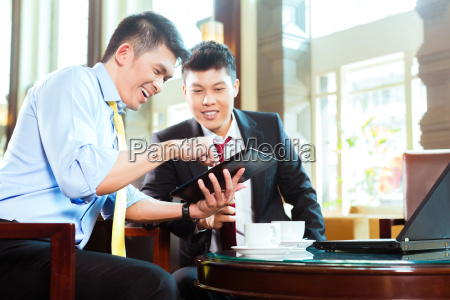 chinese businessmen at business meeting in