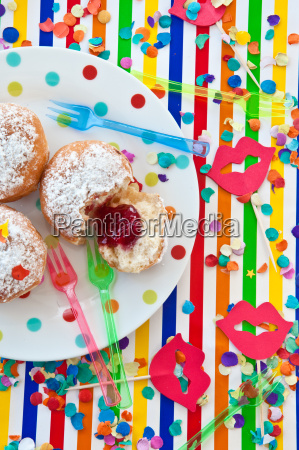 fresh donuts on colorful plate