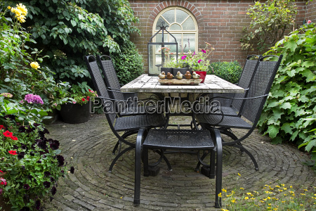 iron forged table and chairs in