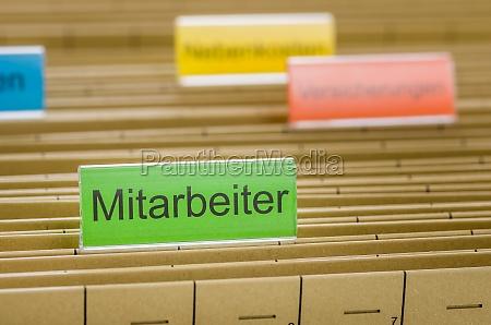 hanging folders labeled employee