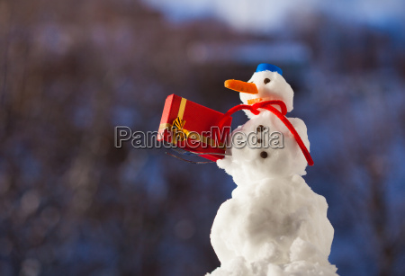 little happy snowman with christmas gift