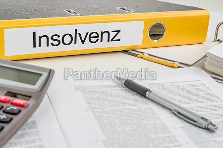 file folders labeled insolvency