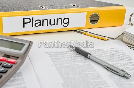 file folders labeled planning