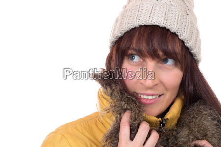 young woman looks up in winter