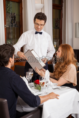 laughing couple having dinner in the