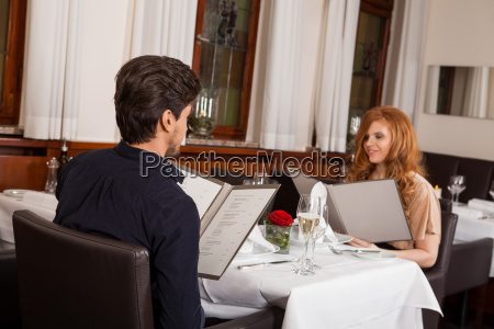 laughing couple having dinner at the