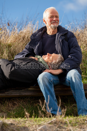 happy relaxed senior couple outdoors in