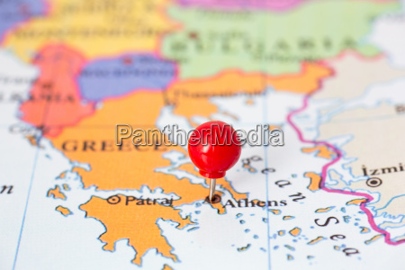 red pushpin on map of greece