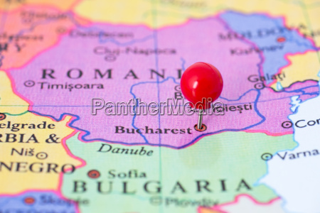 red pushpin on map of romania