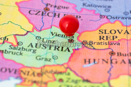 red pushpin on map on austria