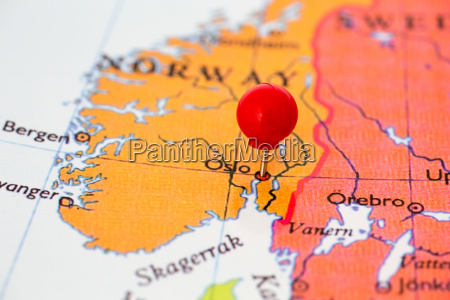 red pushpin on map of norway