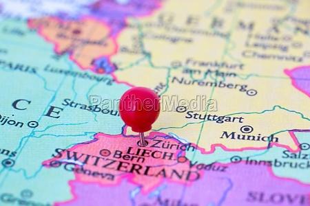 red pushpin on map of switzerland