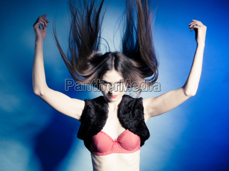 fashionable girl with long hair jumping