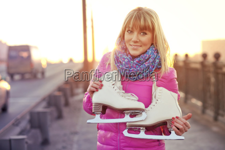 beautiful smiling blond woman with ice