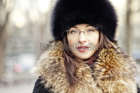 woman wearing fur hat and glasses