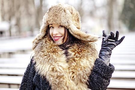 joyfull russian woman in fur hat
