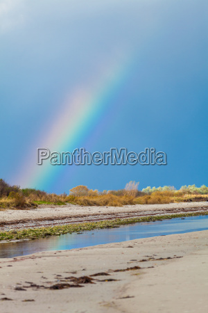 colorful rainbow on the sea at