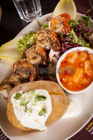 fried prawns on skewers with dipping