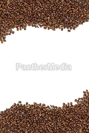 geroestete kaffeebohnen als rahmen oben und
