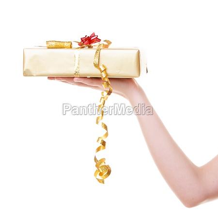 female hand giving christmas gift box