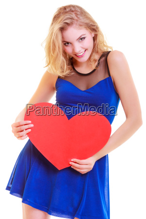 beautiful woman hold valentine day symbol