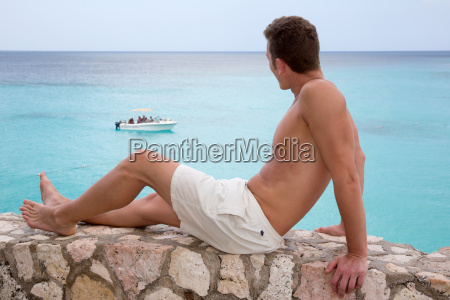 young man looking at the sea