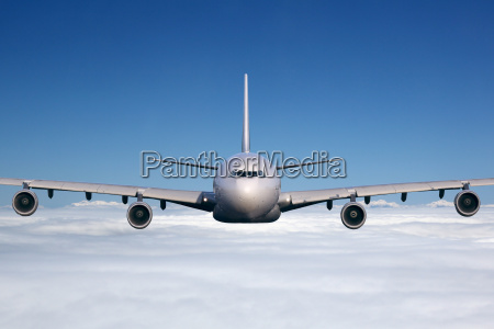 aircraft in flight above the clouds