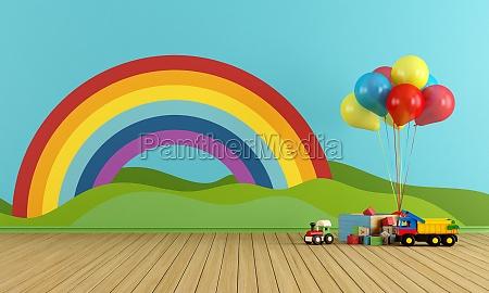 leere spielzimmer mit regenbogen und spielzeug