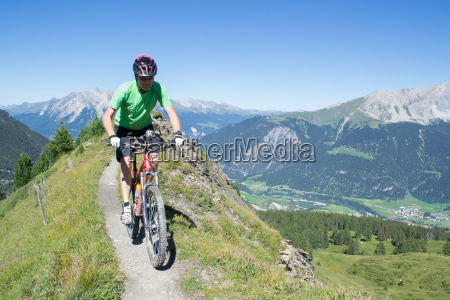 mountain biker riding downhill in swiss
