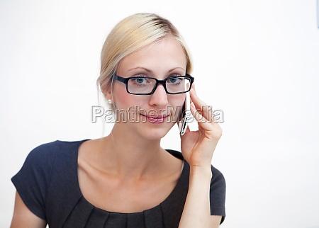 blond businesswoman talking on phone
