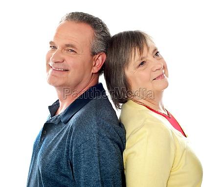 closeup shot of aged couple back