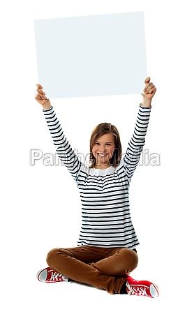 girl holding blank billboard over her