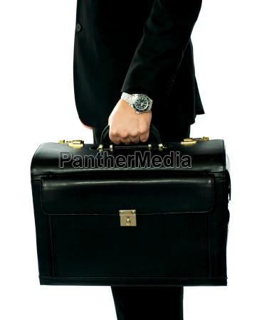 closeup shot of man holding briefcase
