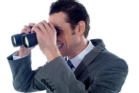 male executive using binoculars