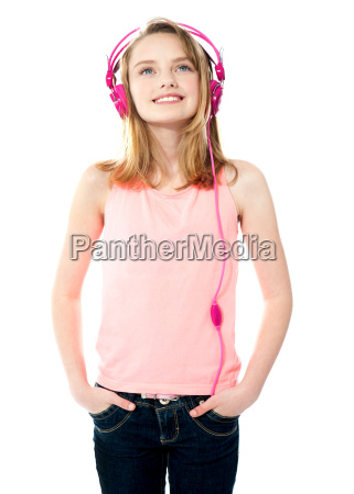 adorable girl tuned into music