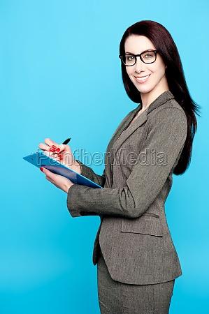 female secretary writing business document