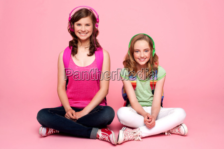 two school friends sitting on studio