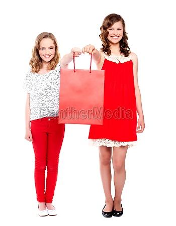 beautiful teenagers holding shopping bag