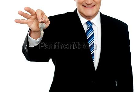 cropped image of businessman holding keys