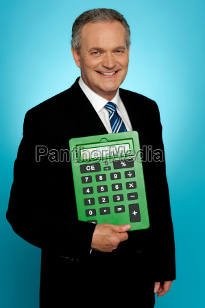 senior executive posing with big green