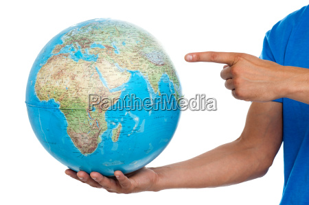 a finger pointing at the globe