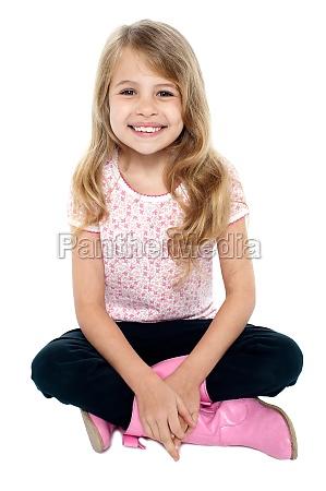 pretty caucasian girl seated on floor