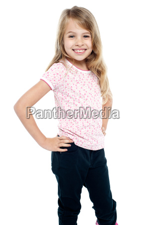 cheerful girl child with hands on