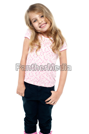shy young girl posing in trendy