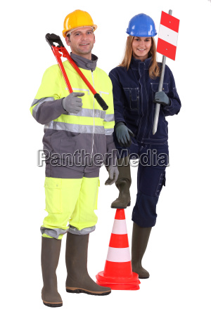manual workers stood with traffic cones