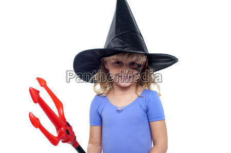 pretty girl in witches hat holding