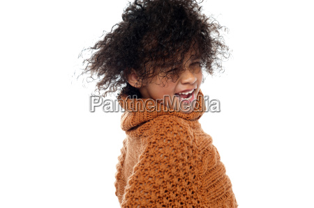 shot of curly haired girl having