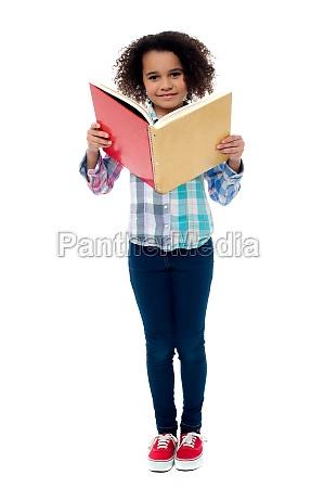 school girl a reading book